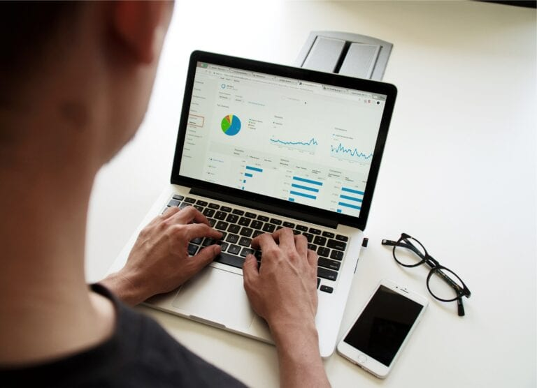 Man researching data on a laptop