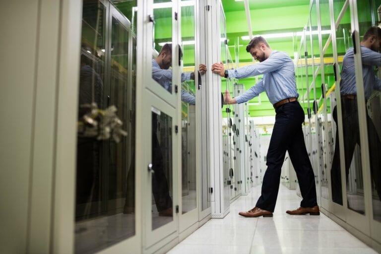 Technician Adjusting Data Server Cabinet