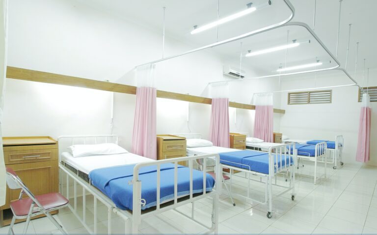 Hospital beds sanitized using ultraviolet cleaning solution systems